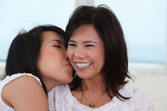Daughter kiss her mother Royalty Free Stock Photo