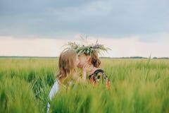 Daughter mom love hugs kiss flower field royalty free stock photo