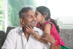 Daughter kissing dad Stock Photo