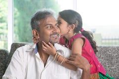 Daughter kissing dad Stock Photo