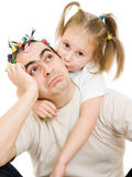 Daughter kissing her father Royalty Free Stock Image