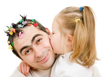 Daughter kissing her father Royalty Free Stock Images