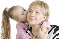 Daughter kissing her mother. Royalty Free Stock Photo