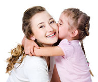 Daughter kissing her mother stock images