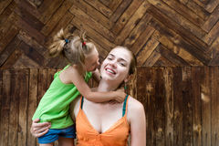 Daughter kissing her mother Stock Photography