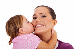 Daughter kissing mother Royalty Free Stock Image