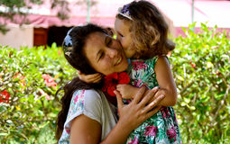 Daughter kissing mother. Royalty Free Stock Image