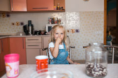 Daughter in kitchen smile to the camera. Daughter in kitchen,happy children haveing fun and eating food royalty free stock photo