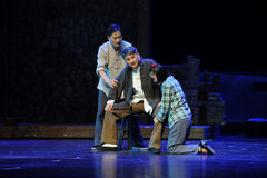 Daughter kneeling to persuade father- Jiangxi opera a steelyard Stock Image