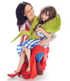 The daughter on a lap at mother. Cute daughter sitting in mother's lap  over white Stock Images