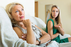 Daughter  and   mature mother having conflict Royalty Free Stock Photo