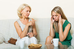 Daughter and mature mother having serious talking Stock Images