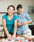 Daughter with mature  mother making  berries perogies Stock Photo