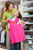 Daughter and mom choosing apparel Stock Photo