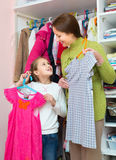 Daughter and mom choosing apparel Royalty Free Stock Photos
