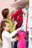 Daughter and mom choosing apparel Royalty Free Stock Image