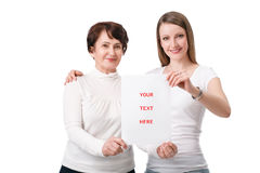 Daughter and mom holding blank board Stock Photography