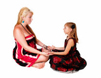 Daughter and mom playing. stock photography
