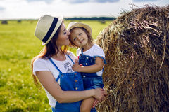 Daughter with mom standing in the field Stock Photos