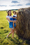 Daughter with mom standing in the field Royalty Free Stock Images