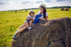 Daughter with mom standing in the field Royalty Free Stock Photography