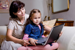 Daughter and mom surfing internet Stock Photo