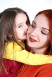 Daughter with mother. Daughter is kissing a mother Royalty Free Stock Image