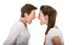 Daughter and mother angry moment. White background Royalty Free Stock Photos