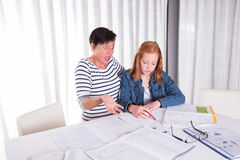 Daughter and mother are clueless regarding homework Stock Image