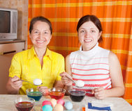 Daughter and mother coloring eggs Royalty Free Stock Photo