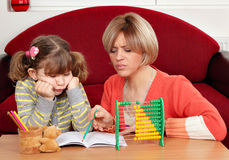 Daughter and mother doing homework Royalty Free Stock Images