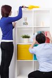 Daughter and mother during dusting. Daughter and her mother during dusting furniture stock photos