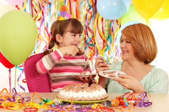 Daughter and mother eat birthday cake Royalty Free Stock Photo