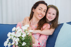 Daughter and mother with flowers Stock Photos
