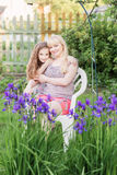 Daughter with  mother in the garden Stock Image