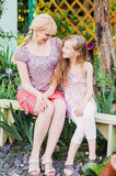 Daughter with mother in the garden Royalty Free Stock Image