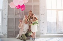 Daughter, mother and grandmother at home stock photo