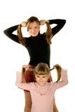 Daughter and mother having fun. Daughter and her mother with the same hairstyle stock images
