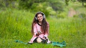 Daughter and mother headphones stock video