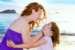 Daughter and mother hug on the Ibiza beach Stock Photos