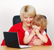 Daughter and mother with laptop Stock Images