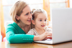 Daughter and mother looking at a laptop Royalty Free Stock Image