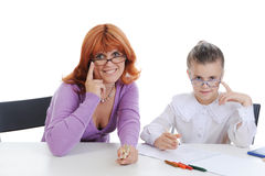 Daughter and mother makes lessons. Royalty Free Stock Photos