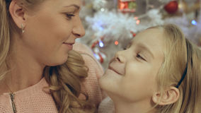 Daughter with mother near the decorated Christmas tree Stock Images