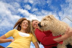 Daughter mother and pet. Daughter mother and  their pet Stock Images