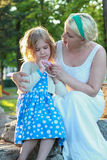 Daughter and mother playing Stock Photography