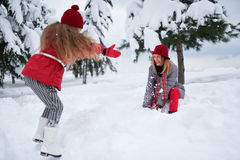 Daughter and mother playing with snow Royalty Free Stock Photos