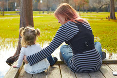 Daughter and mother playing together in park Stock Photo