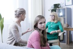 Daughter, mother and psychotherapist. Worried mother, introverted daughter and psychotherapist during session royalty free stock photos