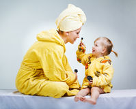 Daughter and mother putting makeup Royalty Free Stock Photo